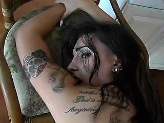 Busty tattooed babe lets you gave it all